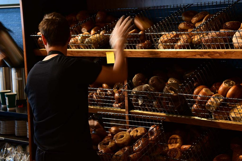 Uncommon Grounds worked adding fresh bagels to the store's stock.